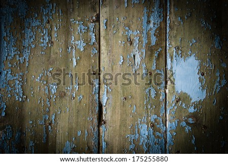 Texture of weathered wooden lining boards with peeling blue paint and rusty nail heads. Shadowed angles. - stock photo