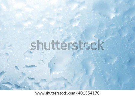 Texture of wet glass with sun glare closeup - stock photo