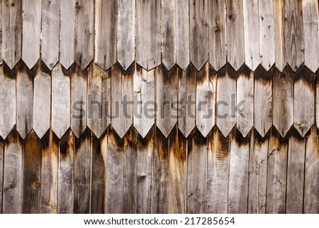 Texture old wall of sharpened wooden planks - stock photo