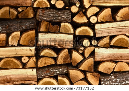 Texture.Pile of chopped fire wood stored and prepared for winter - stock photo