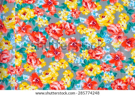 texture silk cloth. Yellow red flowers painted on cloth, abstract pattern.  - stock photo
