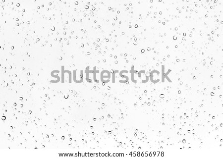 Texture water drops or raindrop on glass of car. - stock photo