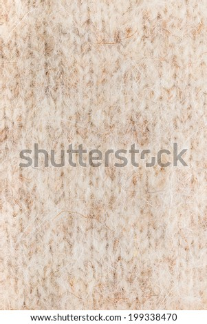 texture wool doggy knitted cloth as a background, closeup  - stock photo