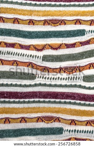 Texture woolen fabric with multi-colored striped pattern, background - stock photo