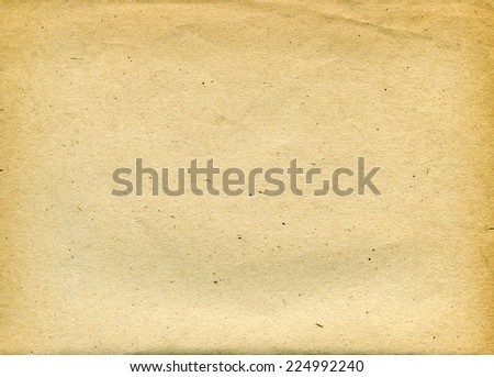 Textured aged recycled paper with natural fiber parts - stock photo