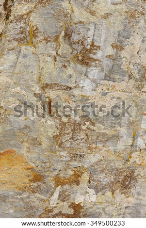 Textured and colored stone abstract background in warm tone. Vertical