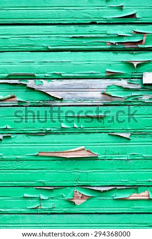 Textured background - bright green peeling paint on old weathered wood  - stock photo