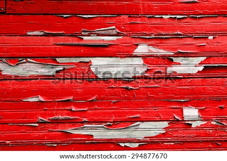 Textured background - bright red peeling paint on old weathered wood  - stock photo