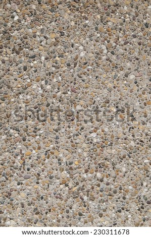 Textured background of exposed aggregate concrete - stock photo