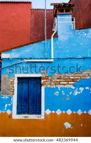 Textured background: old brick wall pattern in Burano, Italy