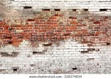 Textured Background Or Studio Backdrop Of Decayed Old Red And White Bricks In The Outdoor Uneven House Wall With Dirty Whitewashed Shabby Plaster - stock photo