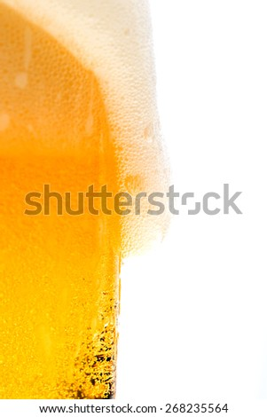 Textured beer with foam and bubbles