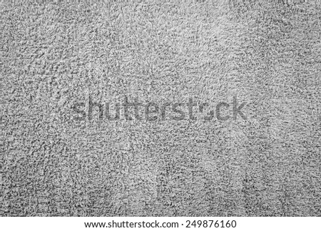 Textured black and white towel. - stock photo