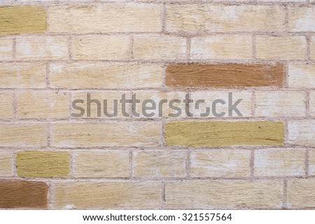 Textured brick wall. Painted in beige - stock photo