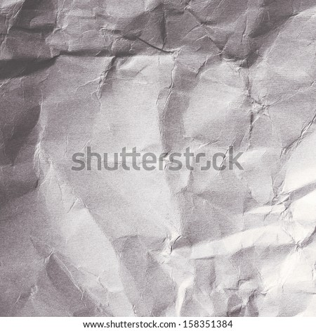 Textured crumpled paper detail with light effect for background with copy space. - stock photo