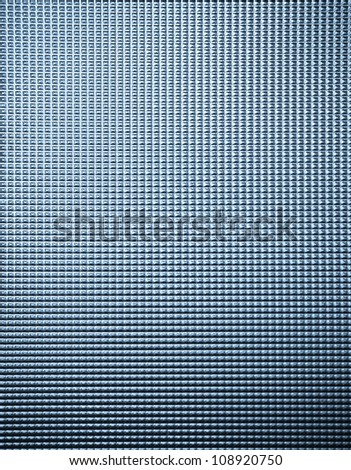Textured glass panel useful as a background - stock photo