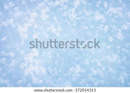 Textured ice blue frozen winter background