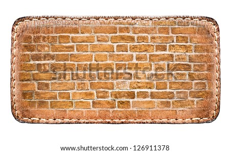 textured materials: clear surface of leather blank brown label closeup view, perspective and successful business concept of promotion products, and grungy red brick wall isolated over white background - stock photo