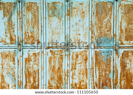 Textured metal wall with stains and rust in Asia - stock photo