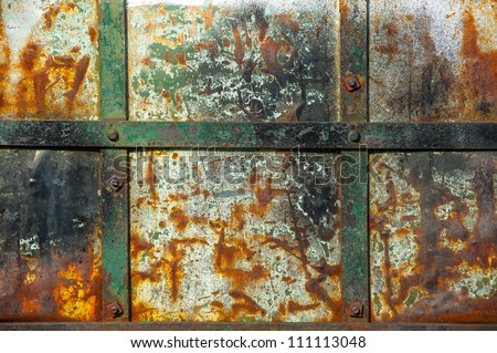 Textured metal wall with stains of rust - stock photo