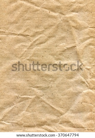 Textured obsolete crumpled packaging brown paper background