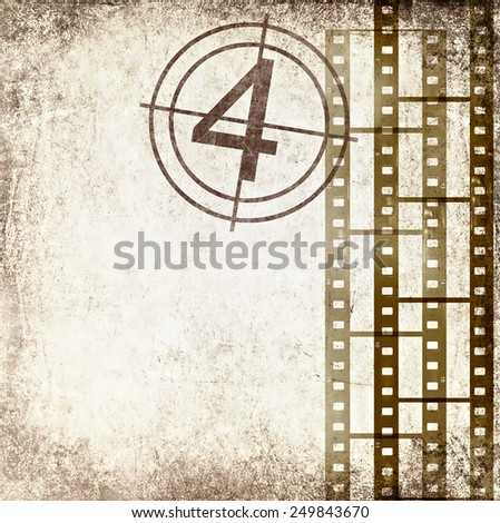 Textured old paper background with films strips and film number. Vintage film stripe cinema abstract background. Image done in retro style with effect of sepia  - stock photo