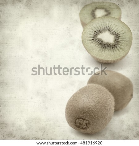 textured old paper background with fresh green kiwifruit