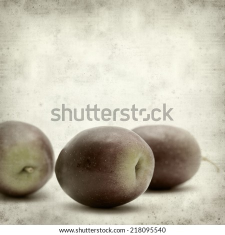 textured old paper background with fresh olives