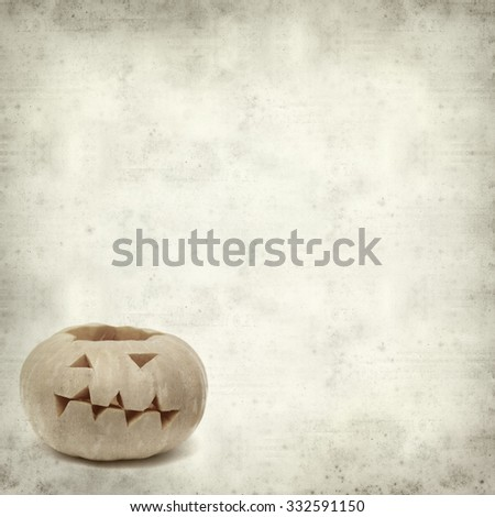 textured old paper background with Halloween pumpkin - stock photo