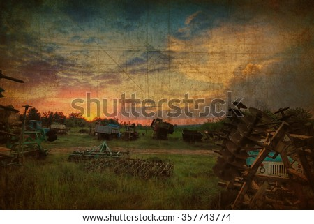 Textured old paper background with image of old destroyed abandoned agriculture farm against magic sunset  - stock photo