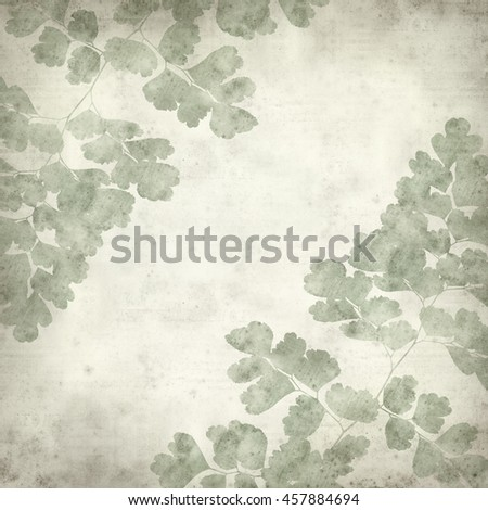 textured old paper background with maidenhair fern leaf
