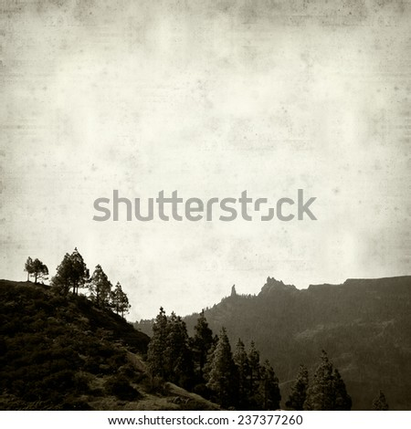 textured old paper background with mountains of Gran Canaria - stock photo