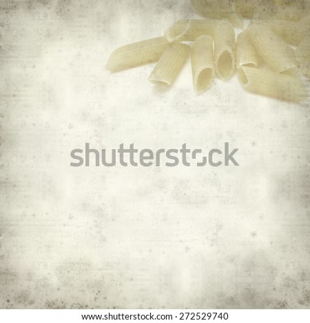 textured old paper background with penne pasta
