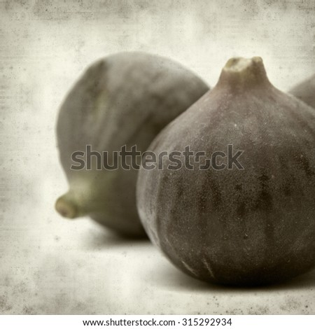 textured old paper background with ripe dark fig fruit