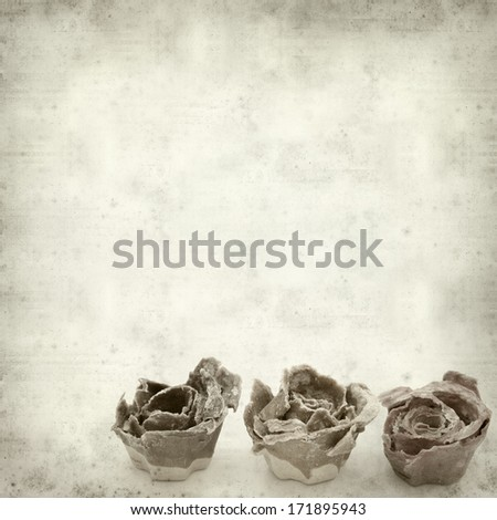 textured old paper background with rose kindling