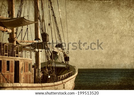 Textured old paper background with sailing ship floating by the sea.Copy space is available - stock photo