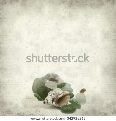 textured old paper background with sea glass pieces