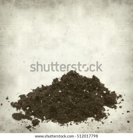 textured old paper background with small heap of compost