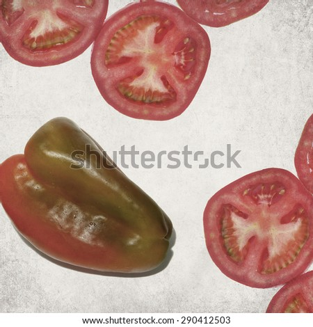 Textured old paper background with tomato slices and sweet pepper (paprika)