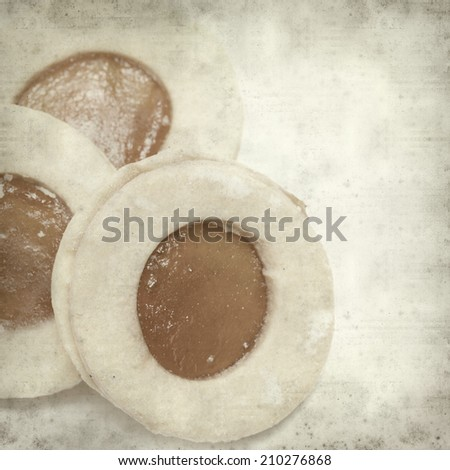 textured old paper background with traditional canarian shortbread with jam