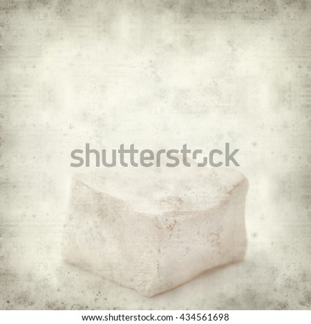 textured old paper background with Turkish delight pieces