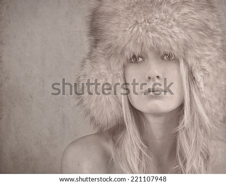 textured old paper background with woman in winter clothes - stock photo