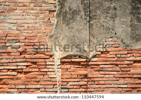 Textured pattern: old weathered brick wall fragment - stock photo