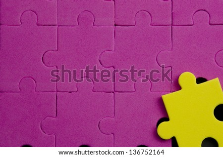 Textured puzzle pieces that show being different, original, special... over black background - stock photo