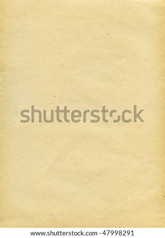 Textured recycled paper with natural fiber parts - stock photo