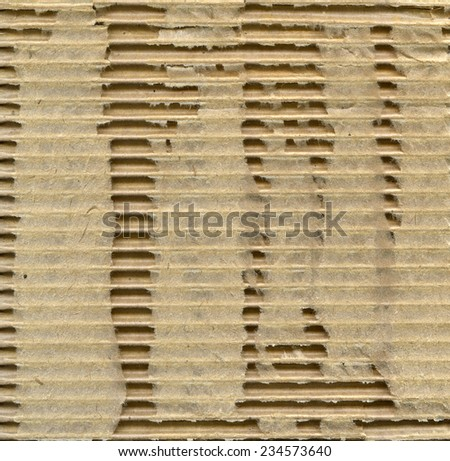 Textured recycled ragged cardboard with natural fiber parts - stock photo