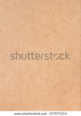 Textured recycled vintage dark beige natural  paper background. - stock photo