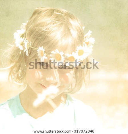 Textured Retro Portrait of Pretty Little Blonde Girl with a Crown of Daisies - stock photo