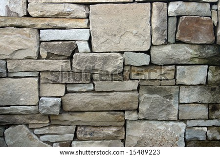 Textured rock wall with various sizes of stones