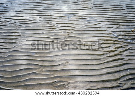 Textured seabed at low tide at the North Sea in Denmark. - stock photo